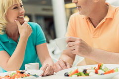 Happy husband and wife resting in cafeteria Stock Photo