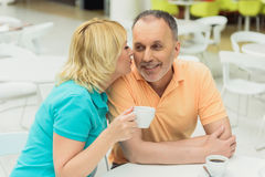 Happy husband and wife resting in cafeteria Royalty Free Stock Photos