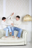 Happy husband and wife sits and fight Royalty Free Stock Images