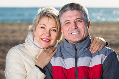 Happy husband and wife spend time together happily at sea beach Royalty Free Stock Image