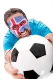Happy icelandic soccer fan with a football Stock Images