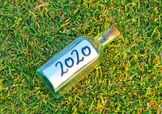 Happy 2020, idea for a new year party on a grassy background of a golf course