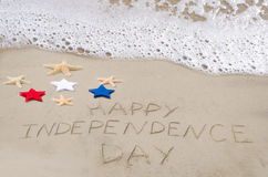 Happy Independence day background. On the sandy beach near ocean Royalty Free Stock Images