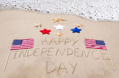 Happy Independence day background. On the sandy beach near ocean Stock Photo