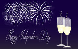 Happy Independence Day. Blue background of fireworks and two glasses of champagne for celebration of Independence Day Royalty Free Stock Photo