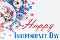 Happy independence day. Celebration, patriotism and holidays concept - close up of cupcakes or muffins decorated with american flags, donut and red blue stock illustration