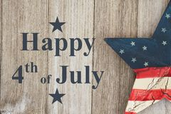 Happy 4th of July Greeting. Happy Independence Day Greeting, USA patriotic old star on a weathered wood background with text Happy 4th of July Day stock images