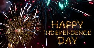 Happy Independence Day. Sparkling text Happy Independence Day on Fireworks Background. Greeting Card For 4th of July. Wide Angle Web banner royalty free stock photo