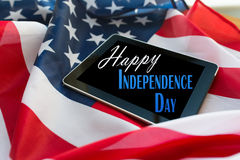Happy independence day on tablet pc american flag Stock Photo