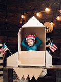 Happy independence day of the usa. Education and kid idea development. Travel and adventure. Earth day. Small boy play. In paper rocket at american flag royalty free stock photography