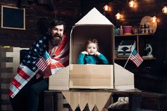 Happy independence day of the usa. independence day of usa with happy family hold american flag at paper rocket. Stock Photo