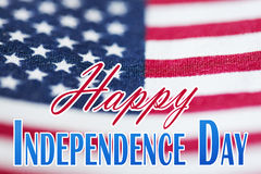 Happy independence day words over american flag Stock Images