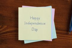 Happy Independence Day written on a note Royalty Free Stock Photo