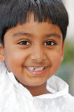 Happy Indian Boy. Happy headshot portrait of cute smiling little Indian boy who's lost his front teeth Royalty Free Stock Images