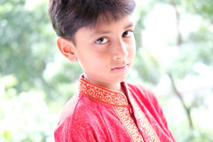 Happy Indian boy wearing traditional dress Stock Photo