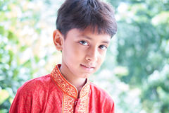 Happy Indian boy wearing traditional dress lookig at camera at outdoor Royalty Free Stock Image