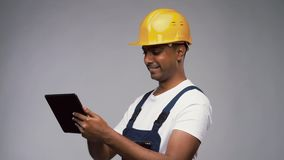 Happy Indian builder in helmet with tablet pc stock footage