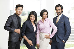 Happy Indian businessman standing with his team. At office Royalty Free Stock Image