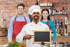 Free Happy Indian Chef With Chalkboard At Cooking Class Stock Images - 147705394