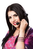 Happy Indian Customer Service Representative. Beautiful Happy Indian Hindu Business Customer Service Representative at call center with headset microphone stock photography