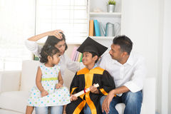 Happy indian family graduation. Education concept photo stock photo