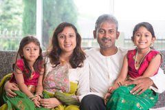Happy Indian family. At home. Asian parents and children living lifestyle, sitting on couch indoor happily royalty free stock image