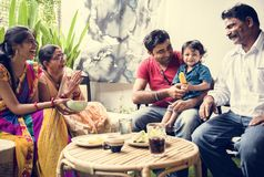 A happy Indian family spending time together at home stock images