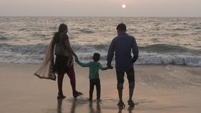 Happy indian family together hand in hand on alappuzha beach stock video