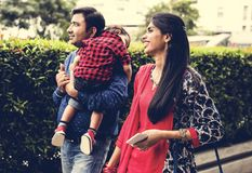 A happy Indian family walking in the park Stock Photo