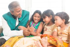 Happy Indian father and daughters playing. Portrait of beautiful Indian family playing at home. Happy Asian father and children indoors lifestyle Stock Image