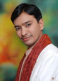 Happy Indian groom. Portrait of handsome young Indian groom in traditional silk wedding clothes Royalty Free Stock Images