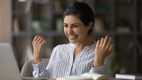 Free Happy Indian Lady Freelancer Excited With Getting Good Contract Online Royalty Free Stock Image - 221097566