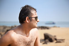 Happy indian man with sunglasses Stock Images