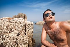 Happy indian man with sunglasses Stock Image