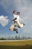 Happy indian person jumping in mid air Stock Images