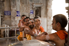 Happy indian priests in temple Stock Image