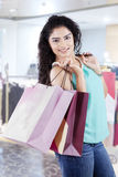Happy indian woman carrying shopping bags Stock Photography