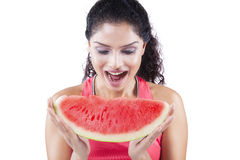 Happy indian woman eating watermelon Royalty Free Stock Image