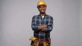 Happy indian worker or builder with crossed arms stock video footage