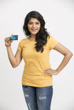 Happy Indian young man showing  credit card. Happy beard Indian young man holding credit card on white Royalty Free Stock Photography