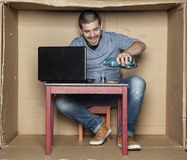 Happy individual topping alcohol. Man in the box stock images