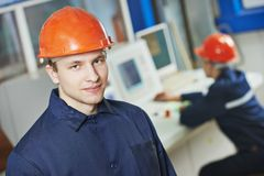 Happy industry worker at factory Stock Photography