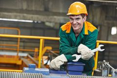 Happy industry worker repairman with spanner Stock Photo