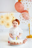 Happy infant baby boy celebrating his first birthday. On home party background Stock Images