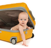 Happy infant baby toddler sitting in yellow plastic travel suitc. Ase on wheels getting ready for vacation isolated on a white background Royalty Free Stock Photos