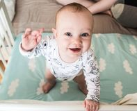Happy infant boy standing. Waving his hand Royalty Free Stock Image