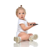 Happy infant child baby boy sitting with mobile cellphone and lo Royalty Free Stock Image