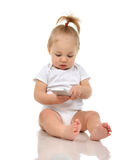 Happy infant child baby boy sitting smiling playing texting Stock Image