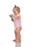 Happy infant child baby boy standing playing with mobile cellpho Stock Images