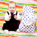 Happy infant with gift Royalty Free Stock Images